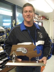 GHS coach Ron Comeau with Div 3 North Finals Trophy