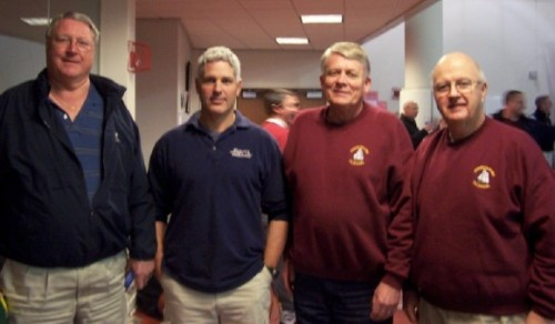 Paul Coleman, Peter Murray, Pete Carlson, and Tom O'Brien pose before another NHS home basketball game.