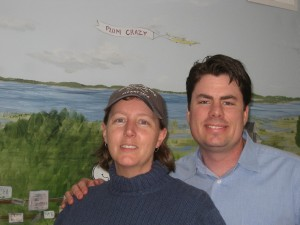 Manager Trish Cram and owner Kurt Littlefield in front of mural inside Plum Crazy.