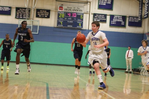 Luke Alley (14) heads for the hoop with Alonzo Jackson (3) closing fast