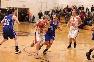 Caroline Soucy (16 points) goes down the lane with Graceann Conte (4)