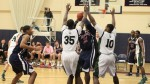 Elijah Macon in heavy Huskie defense