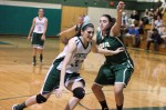 Tess Nogueira (6 points) drives