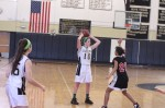 Sarah McAniff (10) looks to pass over Britany Jackson (20)