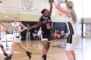 Camileia Collier (15 points) rushes out to defend