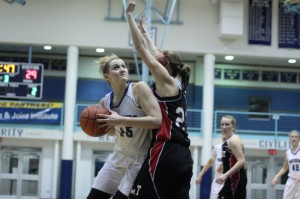 Ashlee Ruzicka (12 points) looks to the hoop
