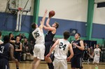Kyle Lentini shoots over Sam Stogdon