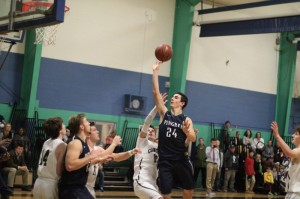 Justin Assad (13 points) floats in the lane