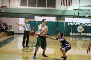 Mike Aiduk, here defended by Raul Navarro, would later score the winning basket for Pentucket