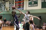 Jake Bordeianu blocks the shot of Mechach Dunn