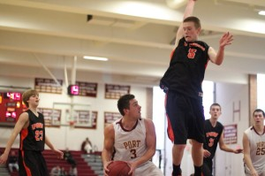 Colton Fontaine (14 points) looks for an opening against Ipswich shot-blocker Erik Fyrer (11 points)