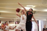 Erik Fyrer goes for the block against Ian Michaels