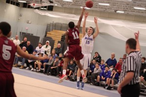 Nick Bates (14 points) takes a three over Anthony Silfa (11)