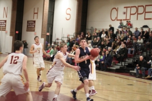 Pat Kearney (31 points) drives past Adam Traxler