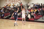 Colby Morris (10 points) shoots over Traverse Briana