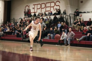 Freshman Dan Baribeault chases a loose ball
