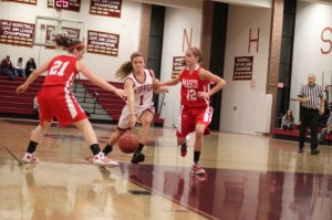 Aly Leahy tries to split two Chieftain defenders