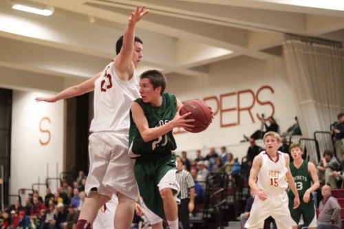 Liam Aldrich (10 points) looks for someone to pass to