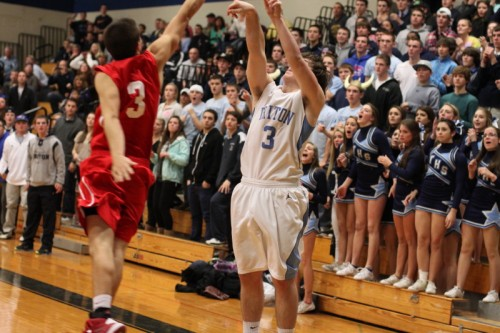 Paul Dacy of Triton shoots the game-winner over Brian Reardon in front of the Viking student section.