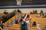 Sam Taylor blocks the shot of Harley Wood