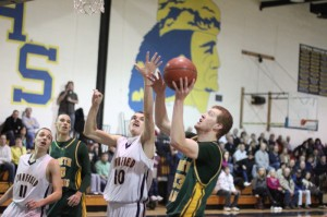 Conor Sullivan (15 points) goes for a block against Chris Capozzoli