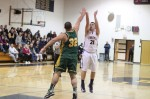 Adam Buchanan (10 points) shoots over John Fortes