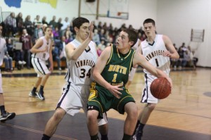 Mike OBrien (13 points) looks for an opening against Paul Pasciuto