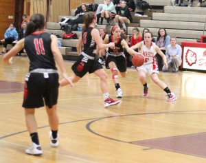 Pam Coufos (10) steals from Meghan Collins (5) late in the game