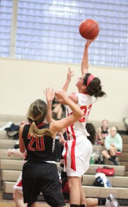 Claudia Marsh (nine points) shoots over McKenzie Mello