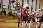 Gia Doonan (nine points) shoots over Kendall Ham