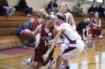 Hayley Newhall puts her shoulder into Katie Vareika