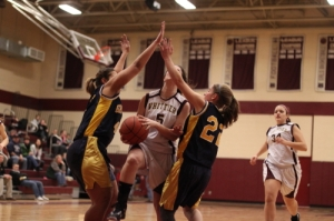 Kayla Riley tries to split the Greater Lowell defense