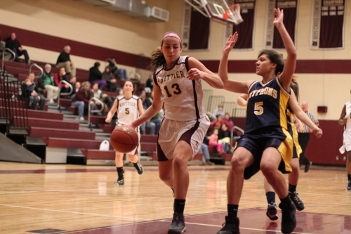 Michaela Martin (24 points) gets in close as Catherine Sweeney tries to avoid fouling