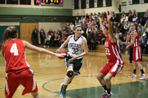 Tess Nogueira (20 points) drives on Claudia Marsh