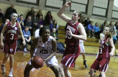 Kat Fogarty (27 points) looks to block the shot of Alexandra Maund (15 points)