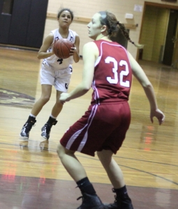 Katie Benzan (16 points) lines up a three