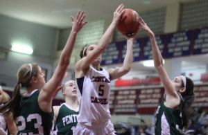 Tess Nogueira (11 points) gets fingers on a shot by Amanda Williams (12 points)