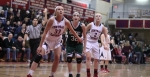 Casey McLaughlin, Tess Nogueira, and Courtney Walsh look for a rebound