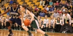 Kelsi McNamara (13 points) drives on Leah Spencer