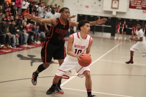 Marvin Baez (9 points) with Daivon Edwards (17 points) behind him