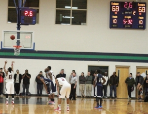 Martez Harrison shoots a second free throw with 2.6 seconds left in regulation