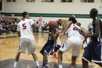 Marquis Moore goes in where shots are blocked