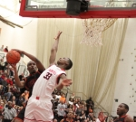 David Kazadi tries to block the shot of Nick Simpson