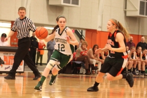 Kelsi McNamara (13 points) dribbles and Brigid OFlynn chases