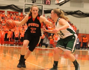 Coley Viselli (13 points) defends against Julia Davis