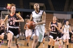 Alana Gilmer (14 points) breaks in