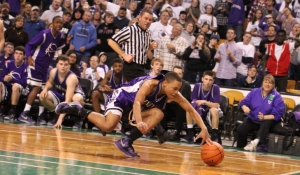 Brandon Watkins chases a loose ball