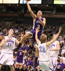 Izak Browne soars into a shot