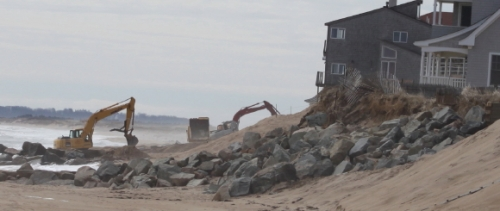 Cranes being used on Plum Island to restore the oceanfront dunes.