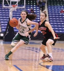 Kelsi McNamara drives on Gabby Coppola